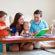 Family drawing and reading — Stock Photo #4730439
