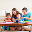 Family drawing and reading - Stock Photo