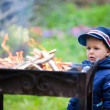 Royalty-Free Stock Photo: Boy looking to fire