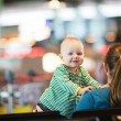 Mother And Baby At Airport. - Stock Photo