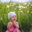 Little girl in meadow - Stock Photo