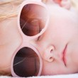 Little girl sleeping at beach — Stock Photo #4731461