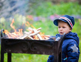 Boy looking to fire — Stock Photo