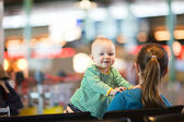 Mother And Baby At Airport. — Stock Photo