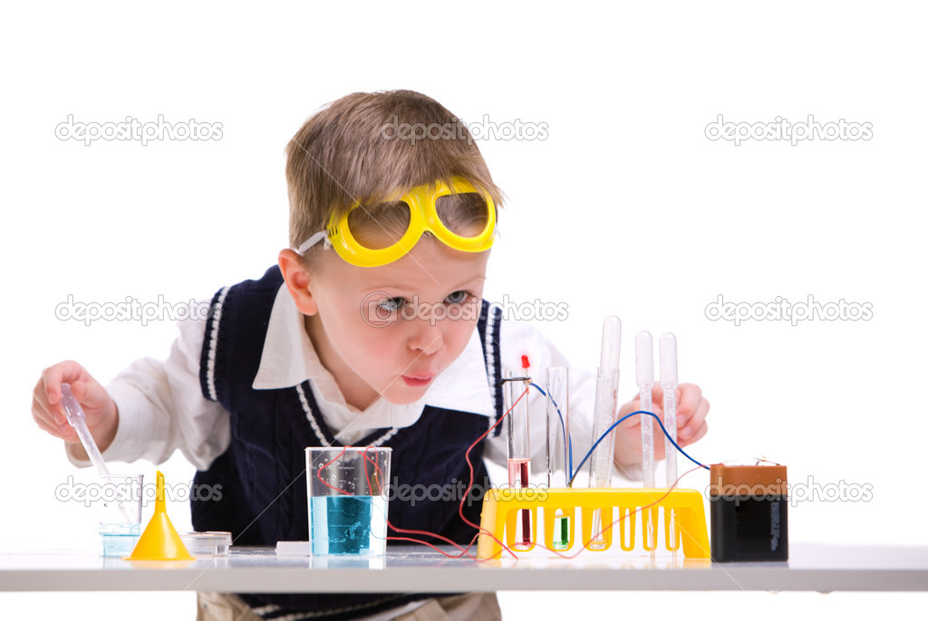 Crazy scientist. Young boy performing experiments with battery and small lamp. — Stock Photo #4730038