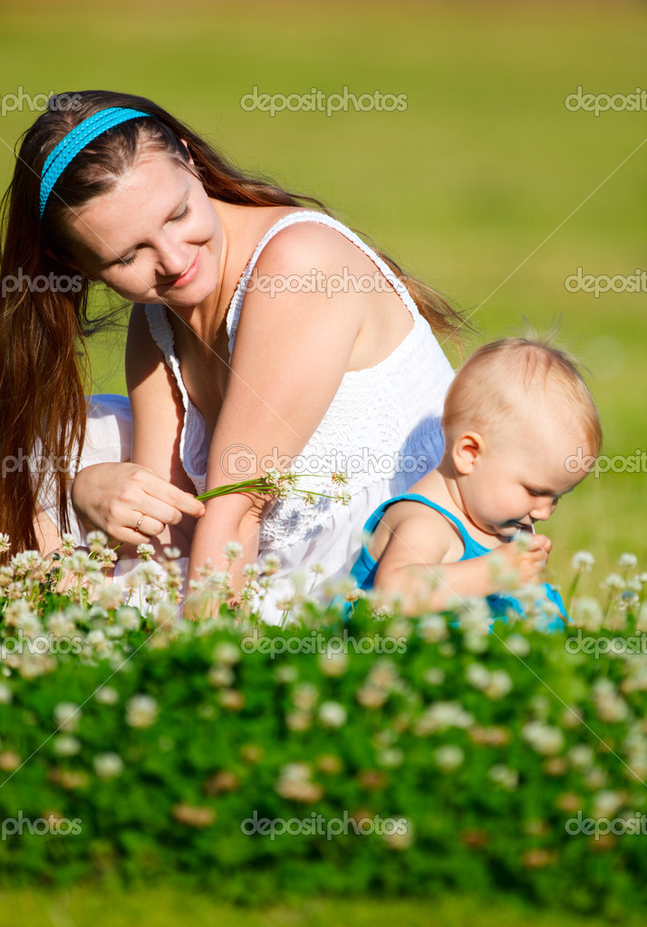 Mother and baby daughter having fun outdoors at sunny summer day  Stock Photo #4730326