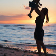 Mother and daughter at sunset — Stock Photo #4805214