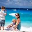Mother with kids on tropical beach — Stock Photo #4805849