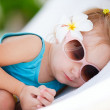 Little girl resting at beach — Stock Photo #4806053