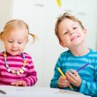 Two kids drawing with coloring pencils — Stok fotoğraf