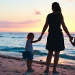 Family at sunset — Stock Photo #4873664