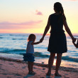 Family at sunset — Stock Photo