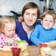 Father and kids baking - Stock Photo