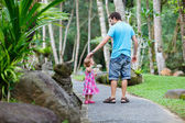 Father and little daughter at tropical park — Stock Photo