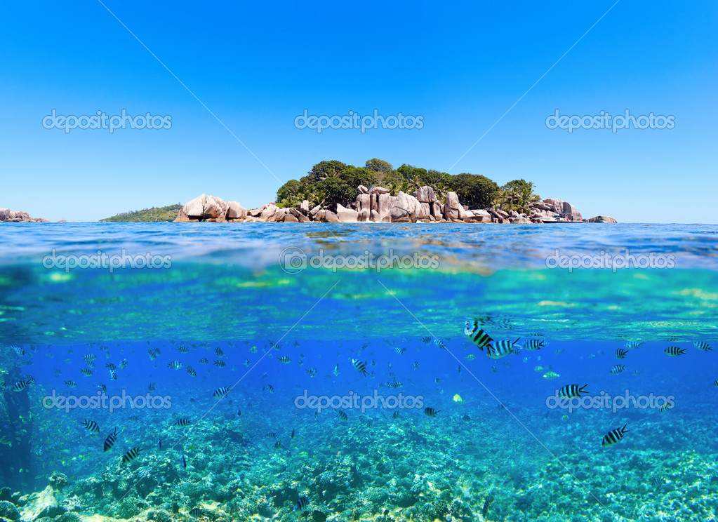 Under and above water photo of small island in Seychelles  Stock Photo #4919122