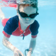 Little boy swimming underwater - Stock Photo