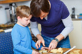 Father and son baking together — Stock Photo