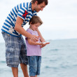 Stock Photo: Father and son caught fish