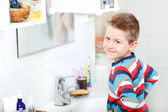 Boy in bathroom — Stock Photo
