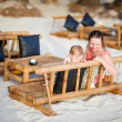 Mother and daughter at beach cafe — Stock Photo