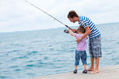 Father and son fishing together — Stock Photo
