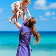 Stock Photo: Mother and daughter on beach vacation