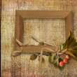 Old frame on wooden background - Stock Photo