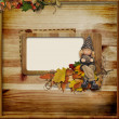 Wooden frame with autumn gnome — Stock Photo