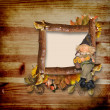Wooden frame with autumn gnome - 图库照片