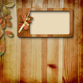Wooden frame with autumn leafs — Stock Photo