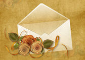 Vintage background with envelope and roses — Stock Photo