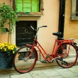 Red bike on nice europestreet — Stock Photo #4039169