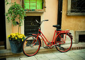 Red bike on a nice european street — Stock Photo