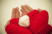 Snowball in hands — Stock Photo