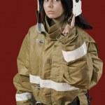 Girl in fireman uniform — Stock Photo
