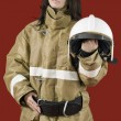 Girl in fireman uniform upstairs — Stock Photo