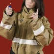 Girl in fireman uniform upstairs — Stockfoto