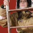 Girl in fireman uniform upstairs — Stock Photo #4330300