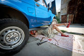Vintage girl with tools under car — Stock Photo