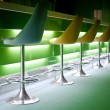 Chairs in row with green lights — Stock Photo