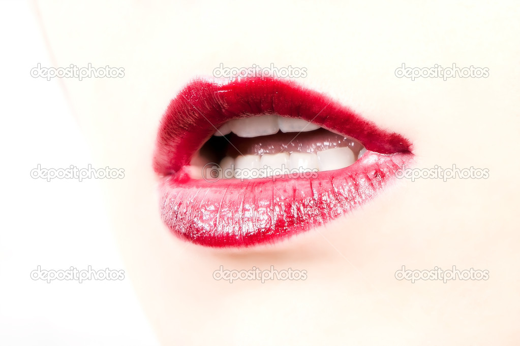 Woman open mouth and lips with red lipstick — Stock Photo #4367755