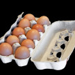 Box with hen eggs isolated on black — Stock Photo