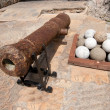 middleage cannon with stone bullets — Stock Photo