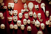 White Venice masks on the wall — Stock Photo