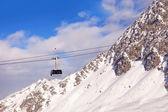 Gondola on cable on mountain resort — Stock Photo