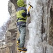 Man with ice axes and crampons — Stock Photo