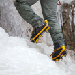 Pair of alpinist boots in crampons — Stock Photo