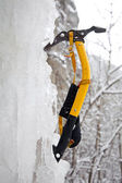 Climbing ice ax in the white ice — Stock Photo