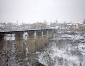 Bridge across the river under snow — Stock Photo
