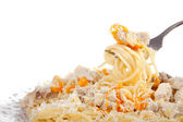 Spaghetti with meat and carrrot on dish isolated on white, cropp — Stock Photo